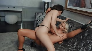 Blonde and brunette are rubbing those vaginas together
